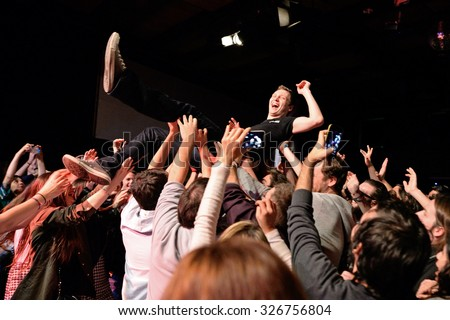 BARCELONA - MAR 18: Crowd cheering in a concert at Bikini stage on March 18, 2015 in Barcelona, Spain. - stock photo