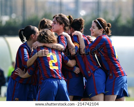 BARCELONA - MAR 14: F.C Barcelona women's football team play against Rayo Vallecano on March 14, 2010 in Barcelona, Spain. Superliga (Women's Football Spanish League) match. - stock photo