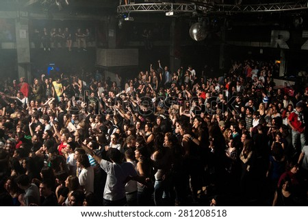 BARCELONA - MAR 18: Large crowd of spanish fans waiting for a concert at Razzmatazz on March 13, 2011 in Barcelona, Spain. - stock photo