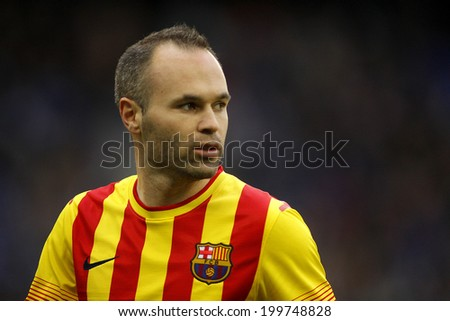 BARCELONA - MARCH, 29: Andres Iniesta of FC Barcelona in action during a Spanish League match against RCD Espanyol at the Estadi Cornella on March 29, 2014 in Barcelona, Spain - stock photo
