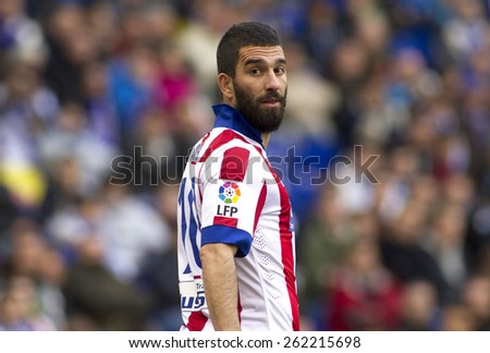 BARCELONA - MARCH, 14: Arda Turan of Atletico Madrid during a Spanish League match against RCD Espanyol at the Estadi Cornella on March 14, 2015 in Barcelona, Spain