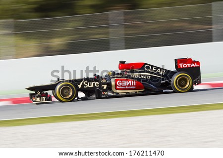 BARCELONA - MARCH 2: Davide Valsecchi racing with his new Lotus Renault E21 at Formula One Teams Test Days at Catalunya circuit on March 2, 2013 in Montmelo, Barcelona, Spain. - stock photo