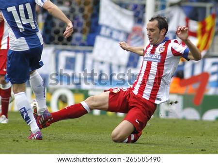 BARCELONA - MARCH, 14: Diego Godin of Atletico Madrid during a Spanish League match against RCD Espanyol at the Estadi Cornella on March 14, 2015 in Barcelona, Spain - stock photo