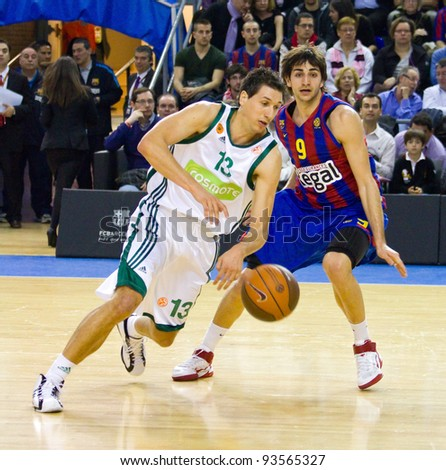 BARCELONA - MARCH 24: Dimitris Diamantidis (L) and Ricky Rubio in action during the Euroleague basketball match between FC Barcelona and Panathinaikos, 71-75, on March 24, 2011 in Barcelona, Spain.