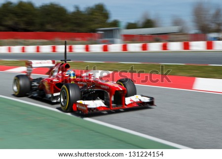 BARCELONA - MARCH 3: Fernando Alonso of Ferrari F1 team during Formula One Test Days at Catalunya circuit on March 3, 2013 in Barcelona, Spain. - stock photo