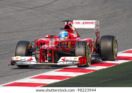 BARCELONA - MARCH 4: Fernando Alonso of Ferrari F1 team races during Formula One Teams Test Days at Catalunya circuit on March 4, 2012 in Barcelona, Spain. - stock photo