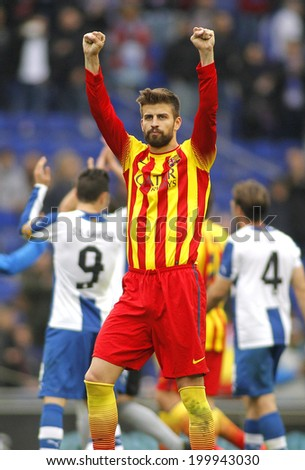 BARCELONA - MARCH, 29: Gerard Pique of FC Barcelona celebrates a goal during a Spanish League match against RCD Espanyol at the Estadi Cornella on March 29, 2014 in Barcelona, Spain - stock photo