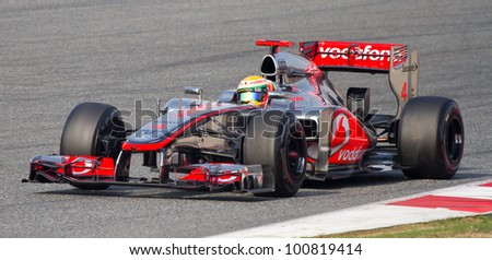 BARCELONA - MARCH 4: Lewis Hamilton of McLaren F1 team races during Formula One Teams Test Days at Catalunya circuit on March 4, 2012 in Barcelona, Spain. - stock photo