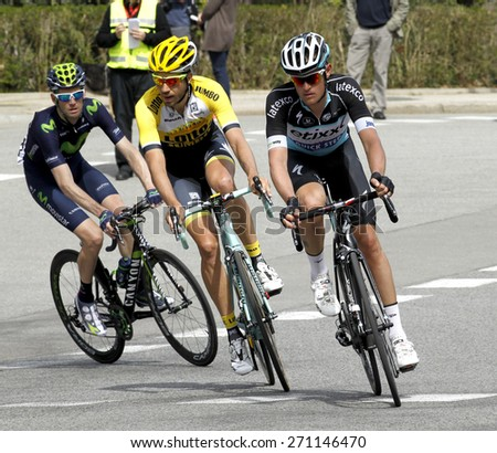 BARCELONA - MARCH, 29: Martijn Keizer(L) and Maxime Bouet(R) ride during the Tour of Catalonia cycling race through the streets of Monjuich mountain in Barcelona on March 29, 2015 - stock photo