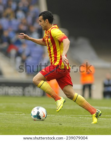 BARCELONA - MARCH, 29: Pedro Rodriguez of FC Barcelona in action during a Spanish League match against RCD Espanyol at the Estadi Cornella on March 29, 2014 in Barcelona, Spain - stock photo