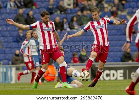 BARCELONA - MARCH, 14: Raul Garcia and Gabi Fernandez of Atletico Madrid during a Spanish League match against RCD Espanyol at the Estadi Cornella on March 14, 2015 in Barcelona, Spain - stock photo