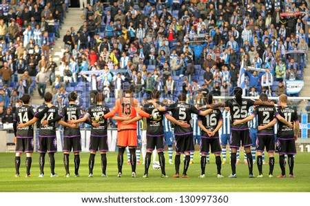 BARCELONA - MARCH, 3: Real Valladolid team in silence minute before a Spanish League match between Espanyol and Valladolid at the Estadi Cornella on March 3, 2013 in Barcelona, Spain - stock photo