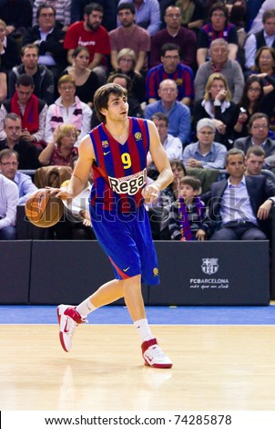 BARCELONA - MARCH 24: Ricky Rubio in action during the Euroleague basketball match between Barcelona and Panathinaikos, 71-75, on March 24, 2011 in Barcelona, Spain.