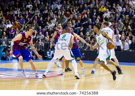 BARCELONA - MARCH 24: Some players in action during the Euroleague basketball match between Barcelona and Panathinaikos, 71-75, on March 24, 2011 in Palau Blaugrana stadium in Barcelona, Spain. - stock photo