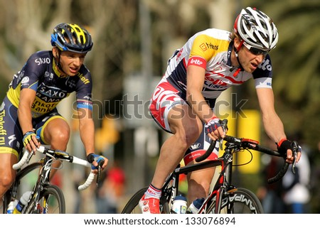 BARCELONA - MARCH, 24: Tim Wellens(R) and Karsten Kroon(L) ride during the Tour of Catalonia cycling race through the roads of Monjuich mountain in Barcelona on March 24, 2013 - stock photo
