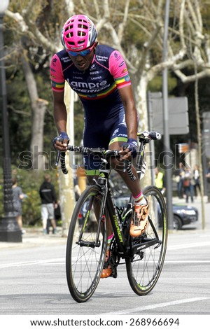 BARCELONA - MARCH, 29: Tsgabu Gebremaryam Grmay of Lampre-Merida rides during the Tour of Catalonia cycling race through the streets of Monjuich mountain in Barcelona on March 29, 2015 - stock photo