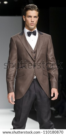 BARCELONA - MAY 11: A model walks on the Fuentecapala catwalk during the Barcelona Bridal Week runway on May 11, 2012 in Barcelona, Spain. - stock photo