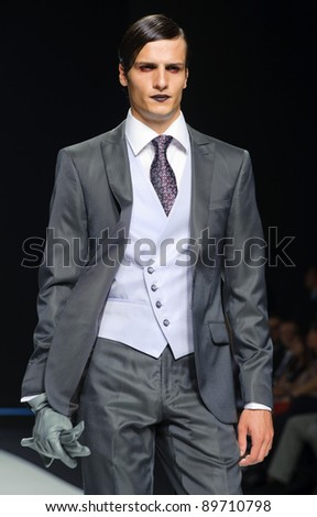 BARCELONA - MAY 13: A model walks on the Fuentecapala catwalk during the Barcelona Bridal Week runway on May 13, 2011 in Barcelona.