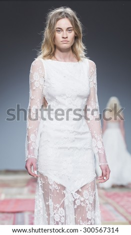 BARCELONA - MAY 08: a model walks on the Houghton bridal collection 2016 catwalk during the Barcelona Bridal Week runway on May 08, 2015 in Barcelona, Spain.  - stock photo