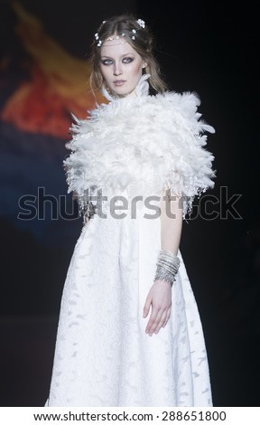 BARCELONA - MAY 06: a model walks on the Jesus Peiro bridal collection 2016 catwalk during the Barcelona Bridal Week runway on May 06, 2015 in Barcelona, Spain.  - stock photo
