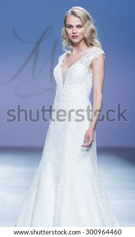 BARCELONA - MAY 08: a model walks on the Justin Alexander bridal collection 2016 catwalk during the Barcelona Bridal Week runway on May 08, 2015 in Barcelona, Spain.  - stock photo