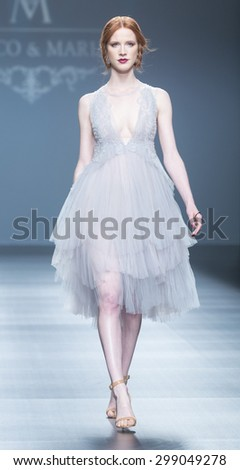 BARCELONA - MAY 07: a model walks on the Marcos & Maria bridal collection 2016 catwalk during the Barcelona Bridal Week runway on May 07, 2015 in Barcelona, Spain.  - stock photo