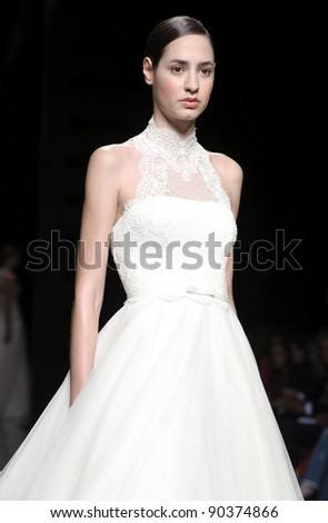 BARCELONA - MAY 10: A model walks on the Rosa Clara catwalk during the Barcelona Bridal Week runway on May 10, 2011 in Barcelona, Spain.