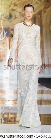 BARCELONA - MAY 01: A model walks on the Yolan Cris catwalk during the Barcelona Bridal Week runway on May 01, 2013 in Barcelona, Spain.  - stock photo