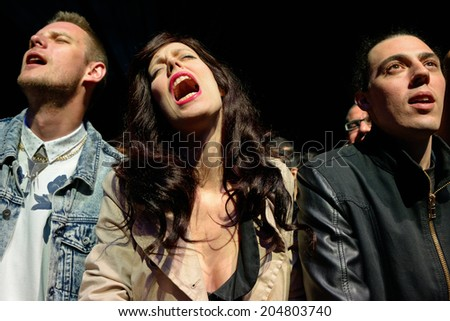 BARCELONA - MAY 31: A woman from the crowd screams in a concert at Heineken Primavera Sound 2014 Festival (PS14) on May 31, 2014 in Barcelona, Spain.