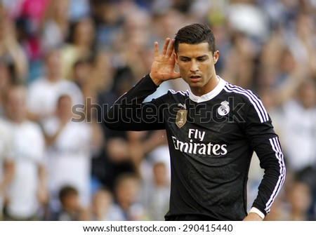 BARCELONA - MAY 17: Cristiano Ronaldo of Real Madrid celebrates a goal during a Spanish League match against RCD Espanyol at the Power8 stadium on May 17 2015 in Barcelona, Spain - stock photo