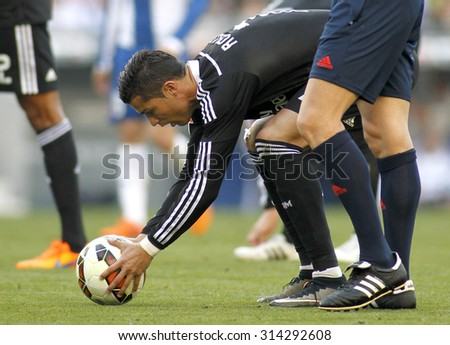 BARCELONA - MAY, 2015: Cristiano Ronaldo of Real Madrid preparing to launch kick off  during a Spanish League match against RCD Espanyol at the Power8 stadium on Maig 17 2015 in Barcelona Spain - stock photo