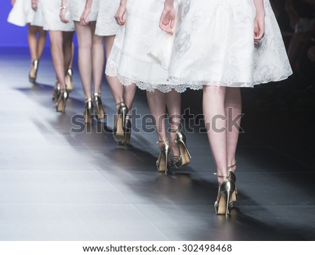 BARCELONA - MAY 06: details of models walking on the Miquel Suay bridal collection 2016 catwalk during the Barcelona Bridal Week runway on May 06, 2015 in Barcelona, Spain.  - stock photo