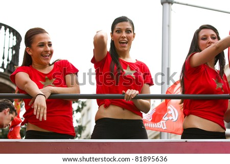 BARCELONA - MAY 29: FC Barcelona cheerleaders perform during the celebration of European Champions League and Spanish League trophies, on May 29, 2011 in Barcelona, Spain. - stock photo