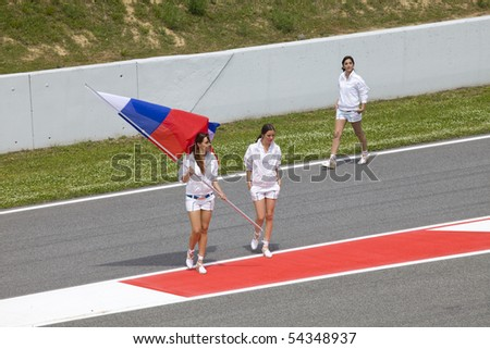"BARCELONA - MAY 9: Girl with flag in honor of russian participant, autodrome ""Catalunya Montmello"" before beginning The Formula 1 Grand Prix on may 9, 2010 in Barcelona, Spain - stock photo"