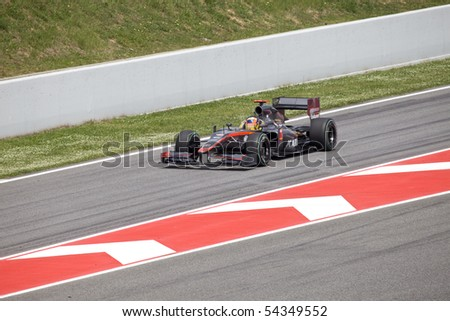 "BARCELONA- MAY 9: Karun Chandhok     of   HRT  in action during The Formula 1 Grand Prix at autodrome ""Catalunya Montmello"" on May 9, 2010 in Barcelona. - stock photo"