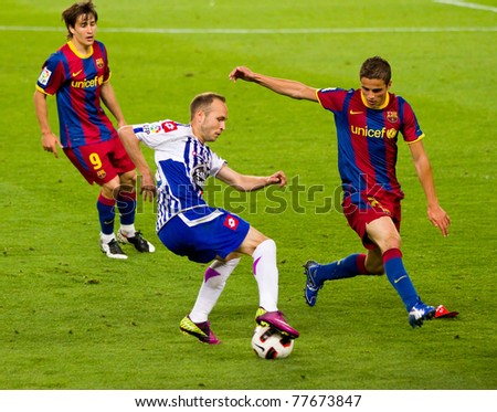 BARCELONA - MAY 15: Laure Sanabria (M) and Ibi Afellay (R) in action during the Spanish League match between FC Barcelona and Deportivo, 0 - 0, on May 15, 2011 in Nou Camp Stadium, Barcelona, Spain.