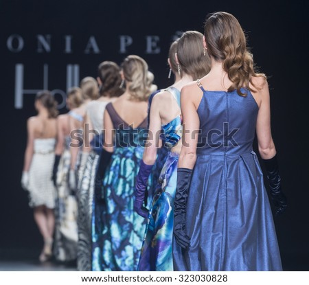 BARCELONA - MAY 07: models walking on the Sonia Pena bridal collection 2016 catwalk during the Barcelona Bridal Week runway on May 07, 2015 in Barcelona, Spain.  - stock photo