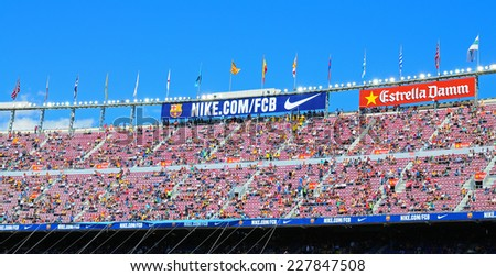 BARCELONA - MAY 03: People at the Camp Nou Stadium prior to the La Liga match between FC Barcelona and Getafe CF on May 3, 2014 in Barcelona, Spain. - stock photo