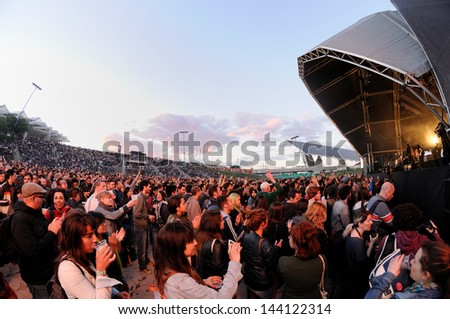 BARCELONA - MAY 22: People in a inaugural free concert at Heineken Primavera Sound 2013 Festival, Ray-Ban Stage, on May 22, 2013 in Barcelona, Spain. - stock photo