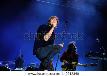 BARCELONA - MAY 23: Phoenix band performs at Heineken Primavera Sound 2013 Festival on May 23, 2013 in Barcelona, Spain. Members: Thomas Mars, Deck d'Arcy, Christian Mazzalai and Laurent Brancowitz. - stock photo