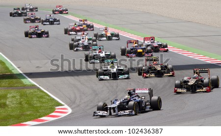 BARCELONA - MAY 13: Some cars racing at the race of Formula One Spanish Grand Prix at Catalunya circuit, on May 13, 2012 in Barcelona, Spain. The winner was Pastor Maldonado of Williams Renault team.