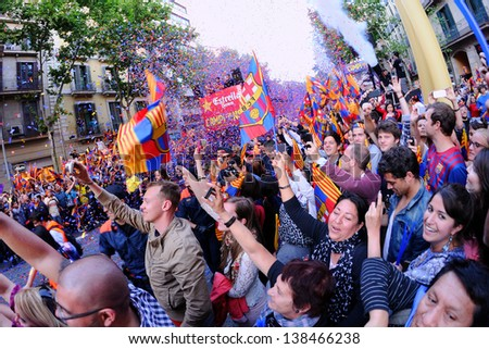 BARCELONA - MAY 13: Thousands of fans of F.C Barcelona football team, celebrates Spanish League La Liga victory in the famous street Rambla Catalunya on May 13, 2013 in Barcelona, Spain.