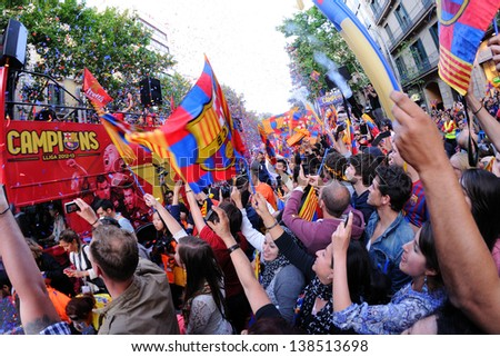BARCELONA - MAY 13: Thousands of people joins Bars players on the streets of the Catalan capital to celebrate the club winning its 22nd league title on May 13, 2013 in Barcelona, Spain. - stock photo