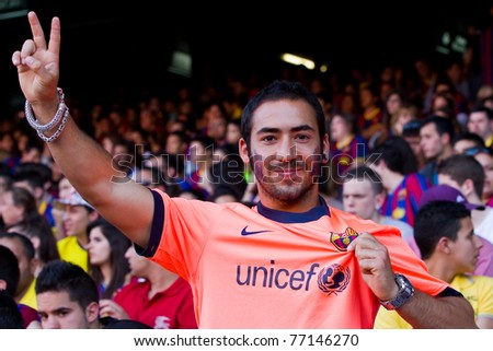 BARCELONA - MAY 13: Unidentified FC Barcelona supporter celebrate the Spanish League Championship victory in Camp Nou stadium, on May 13, 2011 in Barcelona, Spain.