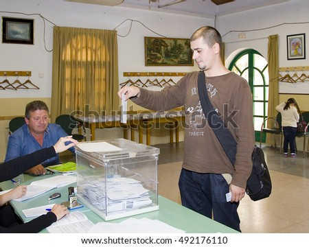 BARCELONA - MAY 25: Unidentified man casts his vote at a polling station during European Parliament Election, on May 25, 2014, in El Masnou, Barcelona, Spain.