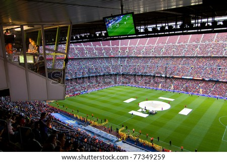 BARCELONA - MAY 13: View of Camp Nou stadium and press box during the FC Barcelona celebration of the Spanish League Championship victory, on May 13, 2011 in Barcelona, Spain. - stock photo