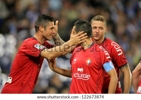 BARCELONA - NOV,10: Kike Sola(L), Miguel Flano(C) and David Timor(R) of Osasuna celebrate goal during a League match against Espanyol at the Estadi Cornella on November 10, 2012 in Barcelona, Spain - stock photo