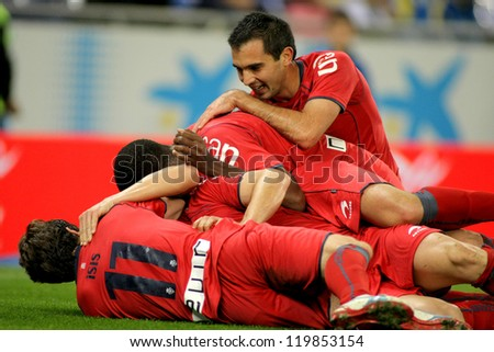 BARCELONA - NOV, 10: Osasuna players celebrating goal during a Spanish League match between Espanyol and Osasuna  at the Estadi Cornella on November 10, 2012 in Barcelona, Spain - stock photo
