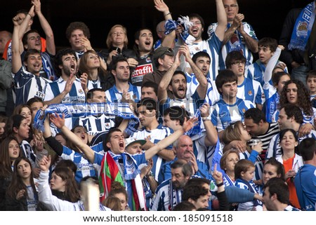 BARCELONA - NOV, 30: Real sociedad supporters celebrating goal during a Spanish league match against RCD Espanyol at the Estadi Cornella on November 30, 2013 in Barcelona, Spain - stock photo