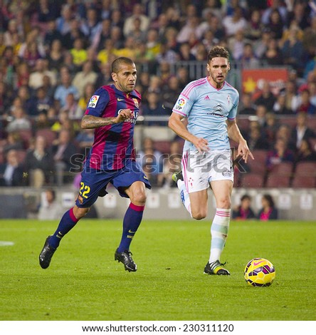 BARCELONA - NOVEMBER 1: Dani Alves (L) of FCB in action at Spanish League match between FC Barcelona and Celta de Vigo, final score 0-1, on November 1, 2014, in Camp Nou stadium, Barcelona, Spain. - stock photo